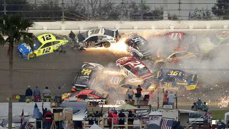 Multiple cars, including Austin Dillon (3), Daniel Suarez (41), David Ragan (38), Paul Menard (21), Ryan Newman (6), Aric Almirola (10), Matt DiBenedetto (95), and Ryan Blaney (12), crash during a NASCAR Daytona 500 auto race Sunday, Feb. 17, 2019, at Daytona International Speedway in Daytona Beach, Fla.