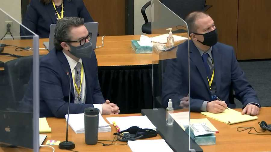 In this image taken from video, defense attorney Eric Nelson, left, and defendant, former Minneapolis police officer Derek Chauvin, right, listen to Hennepin County Judge Peter Cahill during pretrial motions, prior to continuing jury selection in the trial of Chauvin, Thursday, March 11, 2021, at the Hennepin County Courthouse in Minneapolis, Minn.