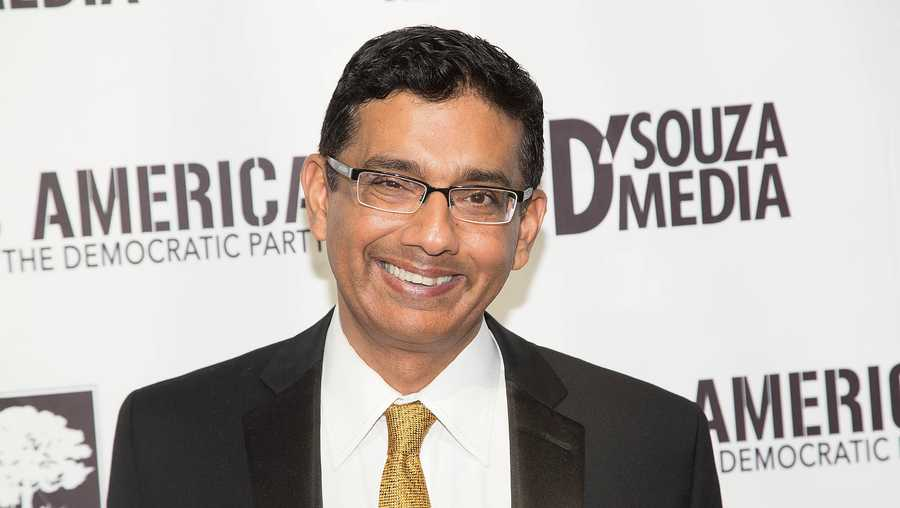 Dinesh D'Souza arrives for the Los Angeles Premiere of, 'Hillary's America,' at TCL Chinese 6 Theatres on July 11, 2016 in Hollywood, California.