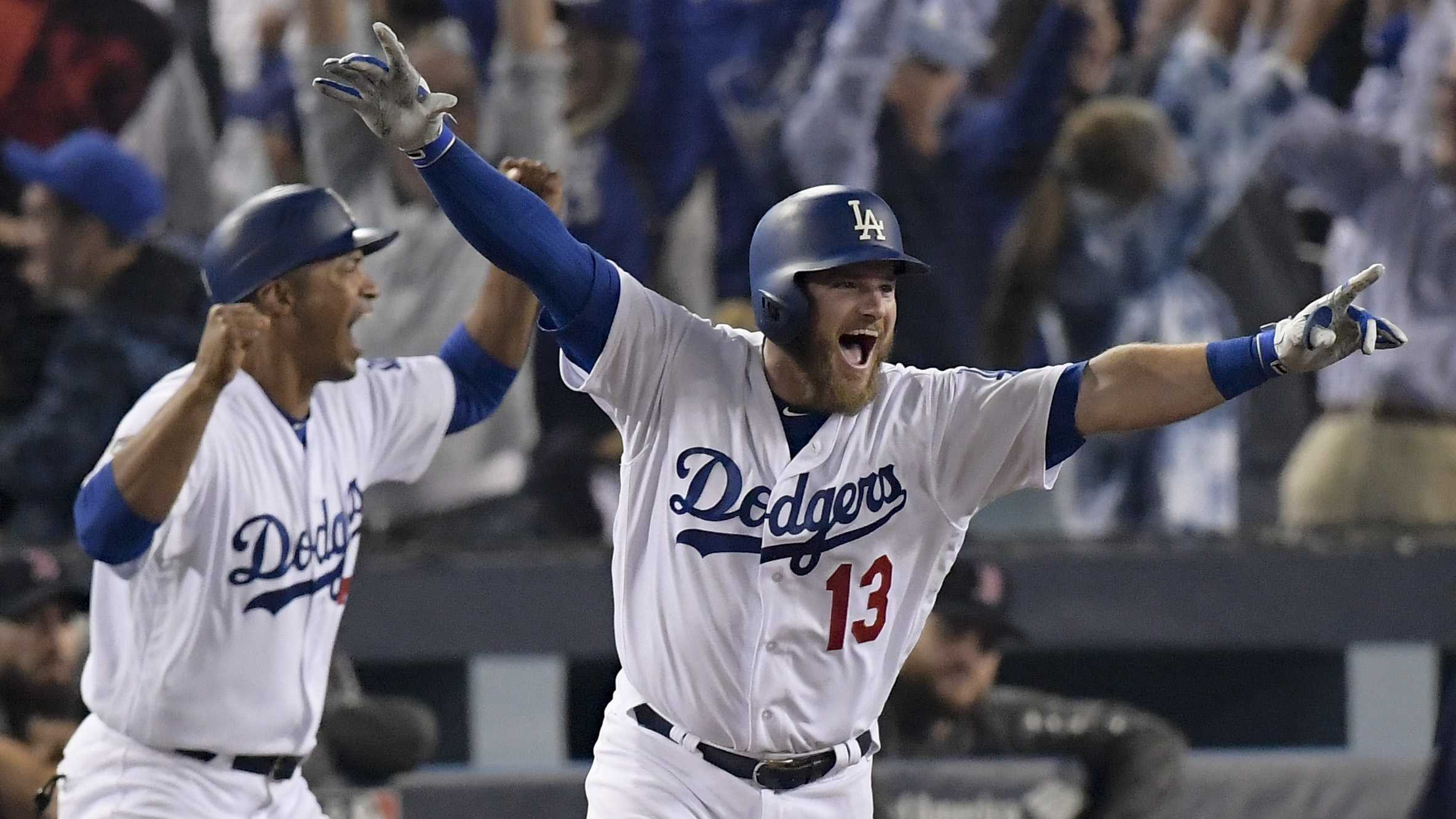 Los Angeles Dodgers' Max Muncy celebrates his walk off home run against the Boston Red Sox during the 18th inning in Game 3 of the World Series baseball game on Saturday, Oct. 27, 2018, in Los Angeles.