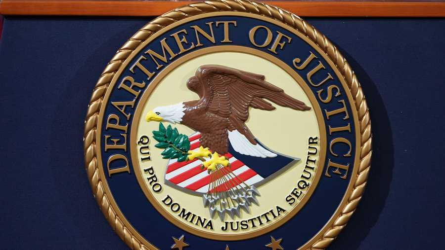 the department of justice seal is seen on a lectern ahead of a press conference announcing efforts against computer hacking and extortion at the department of justice in washington, dc on november 28, 2018 photo by mandel ngan  afp        photo credit should read mandel nganafp via getty images