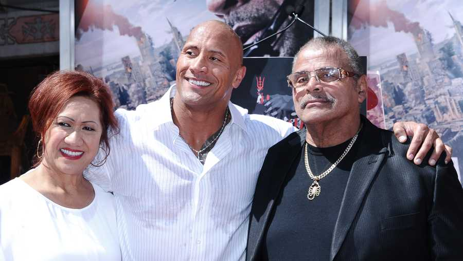 Dwayne Johnson with parents Ata Johnson and Rocky Johnson at his Hand and Footprint Ceremony held at the TCL Chinese Theatre on Tuesday, May 19, 2015, in Los Angeles.