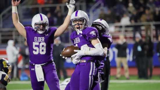 Joe Royer and his teammates celebrate after he scored a touchdown just before the half in Elder's win over Springfield.
