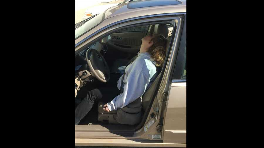 Police snapped this photo of an Indiana mother passed out in her car last year. The 26-year-old Indiana woman says she has been clean since that day, doting on her son and working a full-time j