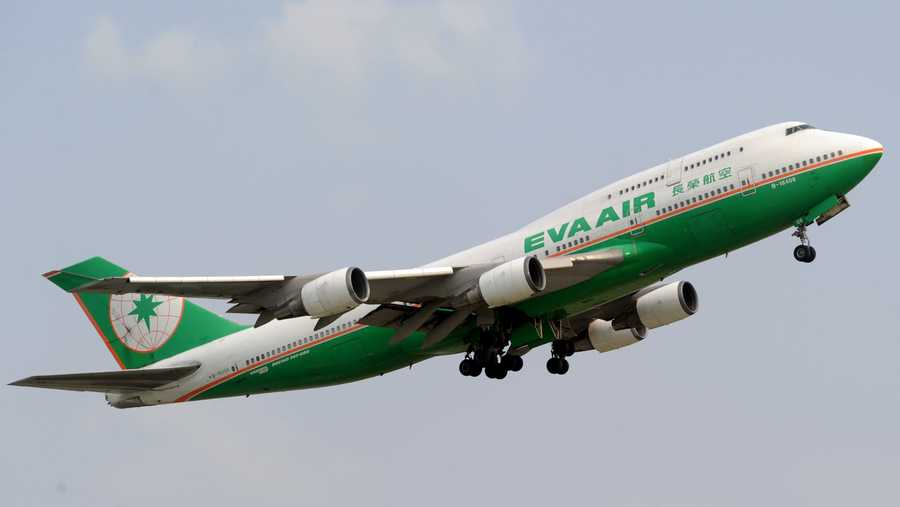 This picture taken in Tangerang on February 15, 2012 shows an Eva air airplane is flying over the Sukarno-Hatta airport in Tangerang.