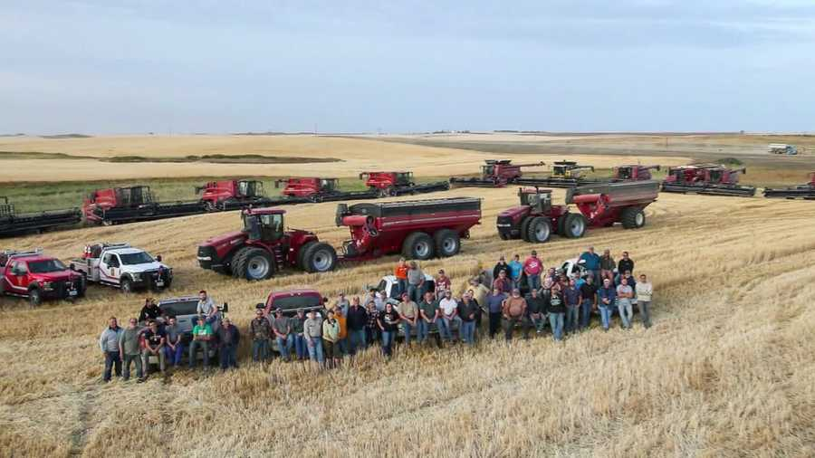 Around 60 neighbors, friends and family of a North Dakota farmer harvested his wheat and canola after the farmer suffered a heart attack during harvest.