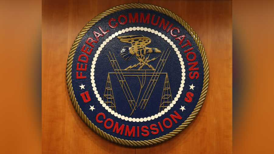 The seal of the Federal Communications Commission hangs inside the hearing room at the FCC headquarters February 26, 2015 in Washington, DC. The Commission will vote on Internet rules, grounded in multiple sources of the Commissions legal authority, to ensure that Americans reap the benefits of an open Internet.