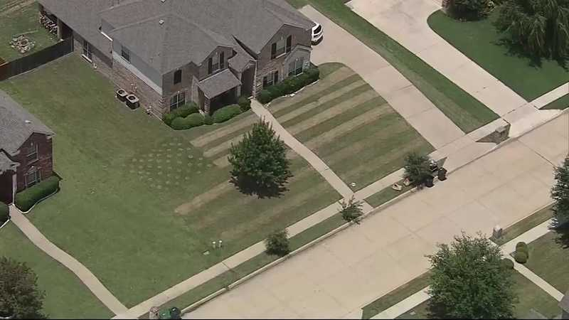 Teen mows flag in lawn