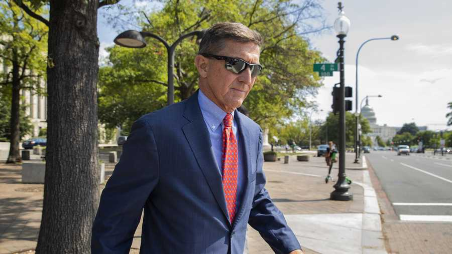 FILE - In this Sept. 10, 2019 file photo, Michael Flynn, President Donald Trump's former national security adviser, leaves the federal court following a status conference in Washington. The arrest of President Donald Trump's former chief strategist Steve Bannon adds to a growing list of Trump associates ensnared in legal trouble. They include the president's former campaign chair, Paul Manafort, whom Bannon replaced, his longtime lawyer, Michael Cohen, and his former national security adviser, Michael Flynn.  (AP Photo/Manuel Balce Ceneta, File)