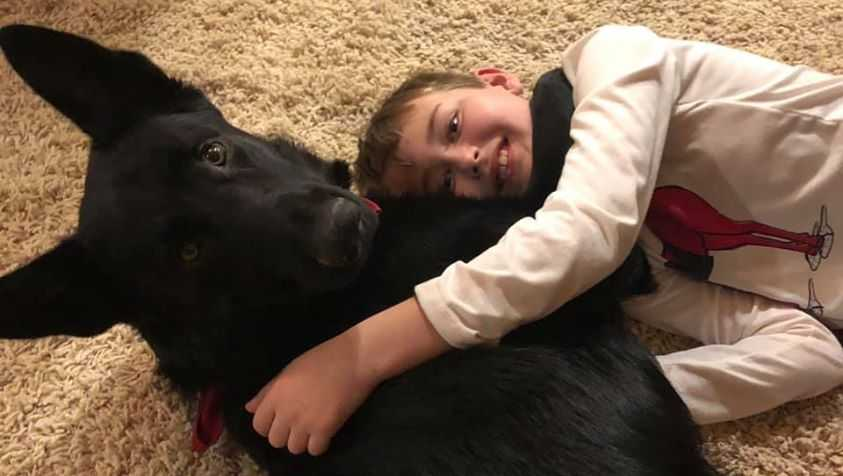 Perryn Miller, who has cancer, reunites with his dog, Frank, in Utah after a stranger transported the animal from North Carolina.
