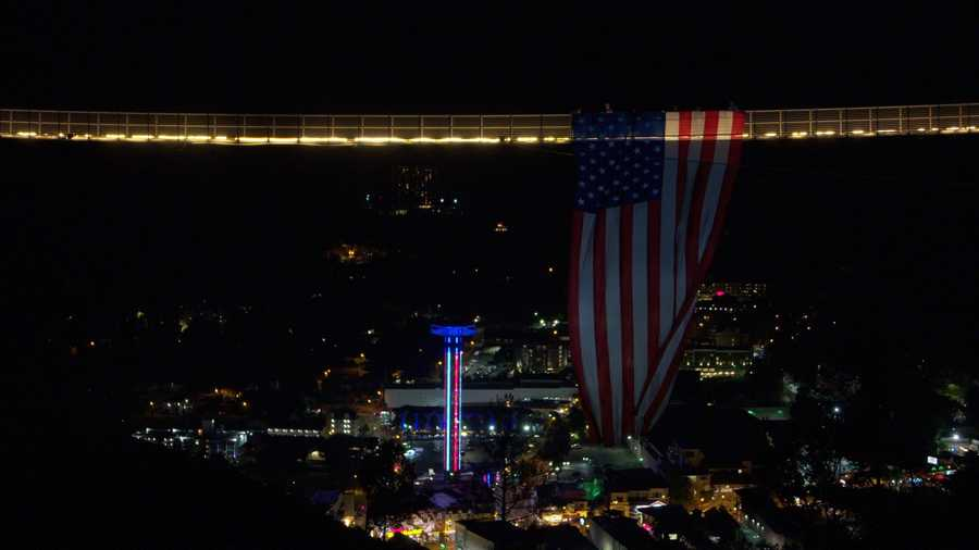 A massive flag hangs from a pedestrian suspension bridge in Gatlinburg, Tennessee.