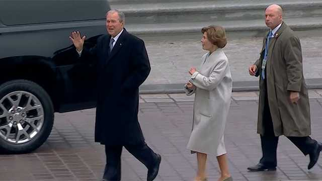 Former President George W. Bush and his wife, Laura, arrive at the Capitol for the inauguration of Donald Trump on Friday, Jan. 20, 2017.