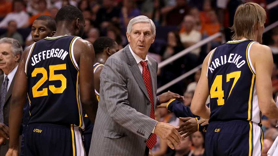 head coach jerry sloan of the utah jazz talks with his team during the preseason nba game against the phoenix suns at us airways center on october 12, 2010 in phoenix, arizona