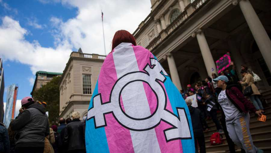 L.G.B.T. activists and their supporters rally in support of transgender people on the steps of New York City Hall, October 24, 2018 in New York City. The group gathered to speak out against the Trump administration's stance toward transgender people. Last week, The New York Times reported on an unreleased administration memo that proposes a strict biological definition of gender based on a person's genitalia at birth.