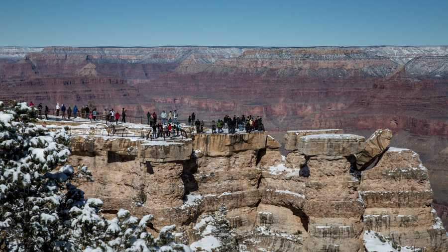 A crowd of tourists gather at Mather Point Lookout, located on the South Rim, to watch the sunrise and take selfies on Feb. 8, 2019, in Grand Canyon National Park, Arizona. Grand Canyon National Park, often considered one of the 'Wonders of the World,' was officially designated a national park on Feb. 26, 1919, and is celebrating its Centennial this year.