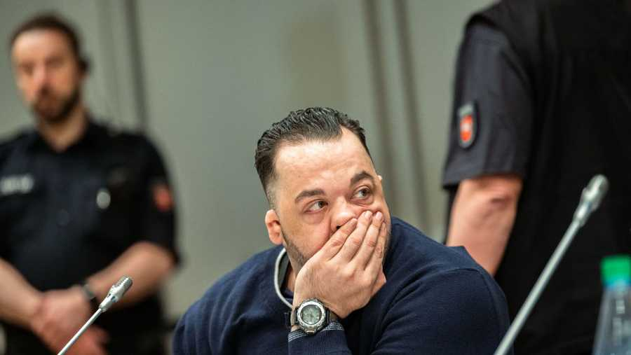 "Former nurse Niels Hoegel, accused of killing more than 100 patients in his care, waits at court for the continuation of his trial in Oldenburg, northern Germany, on June 5, 2019. - The man accused of being post-war Germany's most prolific serial killer was known to colleagues as a ""nice guy"" who did little to arouse suspicion until well into his murder spree. With his verdict expected Thursday, June 6, 2019, prosecutors say Niels Hoegel, 42, a heavy-set, second-generation caregiver, was drunk on power over his ailing patients, whom he picked off at random out of ""boredom""."