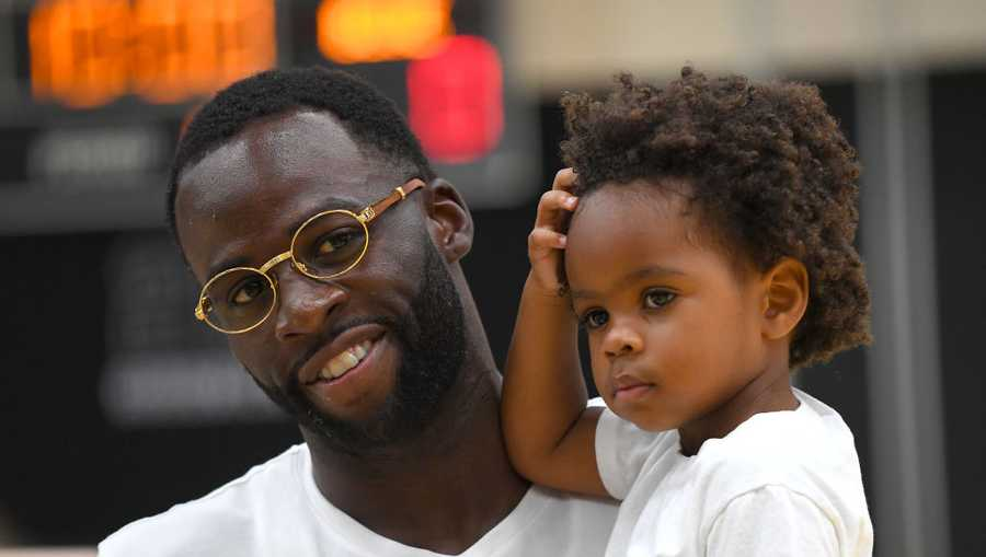 Draymond Green #23 of the Golden State Warriors holds his son Draymond Green Jr. while stopping by the 2019 USA Men's National Team World Cup training camp at UCLA Health Training Center on Aug. 15, 2019, in El Segundo, California.