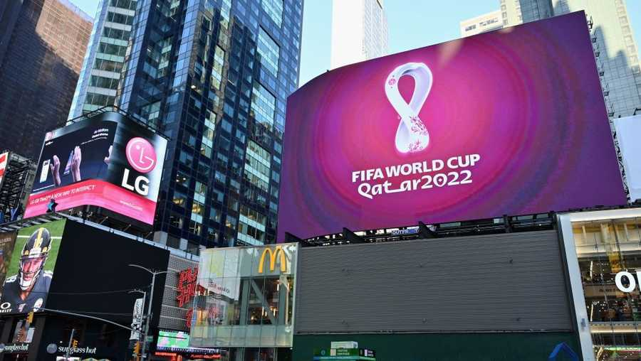 The official 2022 FIFA World Cup Qatar logo flashes on an electronic billboard at Time Square on Sept. 3, 2019 in New York City.