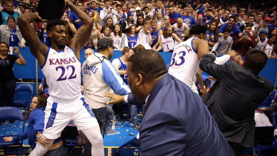 Silvio De Sousa #22 of the Kansas Jayhawks picks up a chair during a brawl as the game against the Kansas State Wildcats ends at Allen Fieldhouse on Jan. 21 in Lawrence, Kansas.
