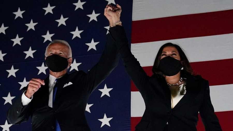Former vice president and Democratic presidential nominee Joe Biden (L) and Senator from California and Democratic vice presidential nominee Kamala Harris greet supporters outside the Chase Center in Wilmington, Delaware, at the conclusion of the Democratic National Convention, held virtually amid the novel coronavirus pandemic, on Aug. 20, 2020.