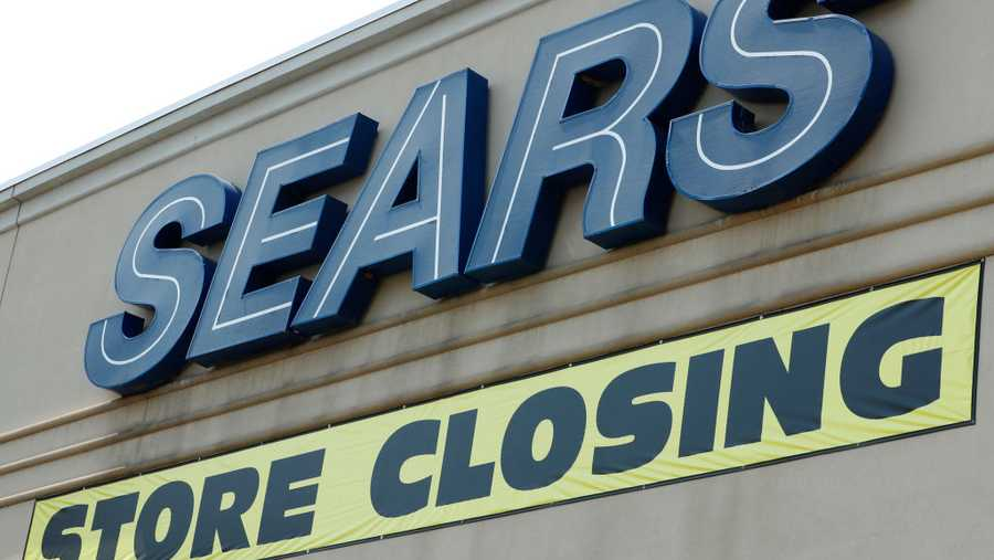A store closing sign hangs under the Sears sign on Sept. 5, 2017, in Provo, Utah. The Sears store which has been open for decades in Provo is one of many store Sears is closing all over the country