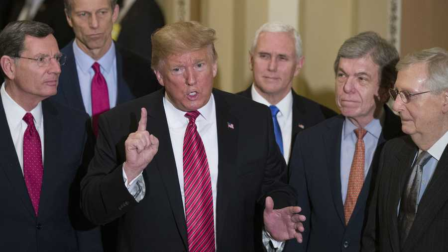 In this Wednesday, Jan. 9, 2019 file photo, Sen. John Barrasso, R-Wyo., left, and Sen. John Thune, R-S.D., stand with President Donald Trump, Vice President Mike Pence, Sen. Roy Blunt, R-Mo., and Senate Majority Leader Mitch McConnell of Ky., as Trump speaks while departing after a Senate Republican Policy luncheon, on Capitol Hill in Washington.