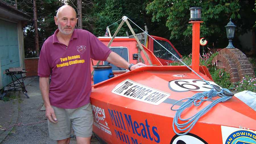 Walters poses with his boat before setting off to break the record.