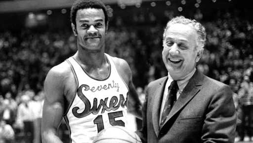 In this Jan. 29, 1971, file photo, Hal Greer (15), of the Philadelphia 76ers, accepts a ball from Sixers owner Irv Kosloff after Greer reached 20,001 points during a basketball game against the Milwaukee Bucks in Philadelphia. The Sixers said Greer died Saturday night, April 14, 2018, in Arizona.