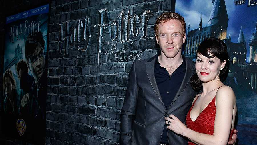 Damian Lewis and Helen McCrory attend the grand opening of Harry Potter: The Exhibition at the Discovery Times Square Exposition Center on April 4, 2011 in New York City.