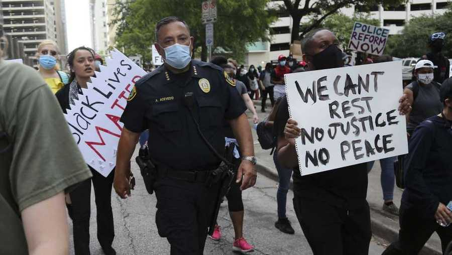Houston police Chief Art Acevedo walks with protesters