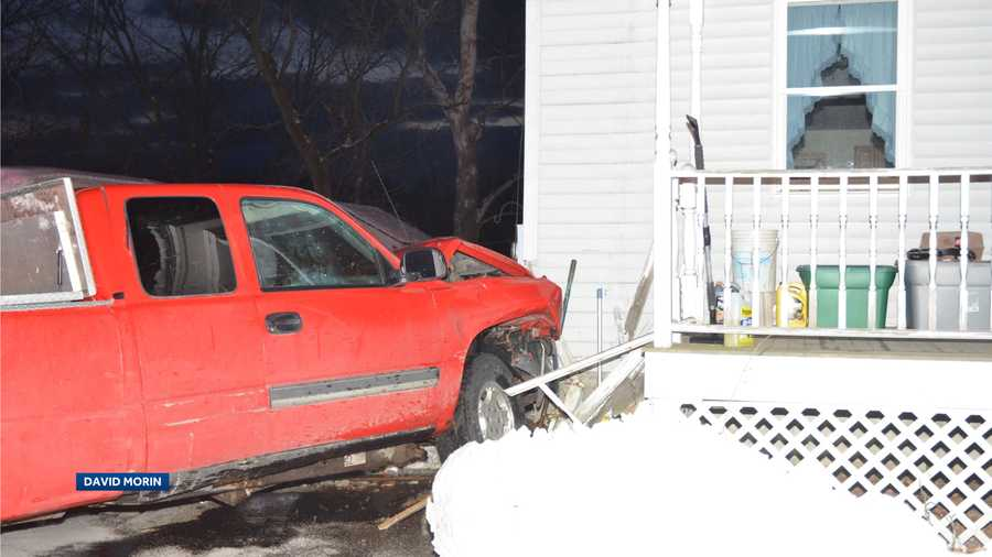 Hudson man charged after striking house with pickup truck