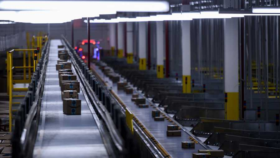 Orders move down a conveyor belt at the 855,000-square-foot Amazon fulfillment center in Staten Island, one of the five boroughs of New York City, on Feb. 5, 2019. - Inside a huge warehouse on Staten Island thousands of robots are busy distributing thousands of items sold by the giant of online sales, Amazon.