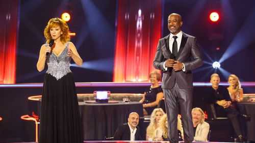 Reba McEntire and Darius Rucker speak onstage during the The 54th Annual CMA Awards at Nashville's Music City Center on Wednesday, Nov. 11, 2020 in Nashville, Tennessee.