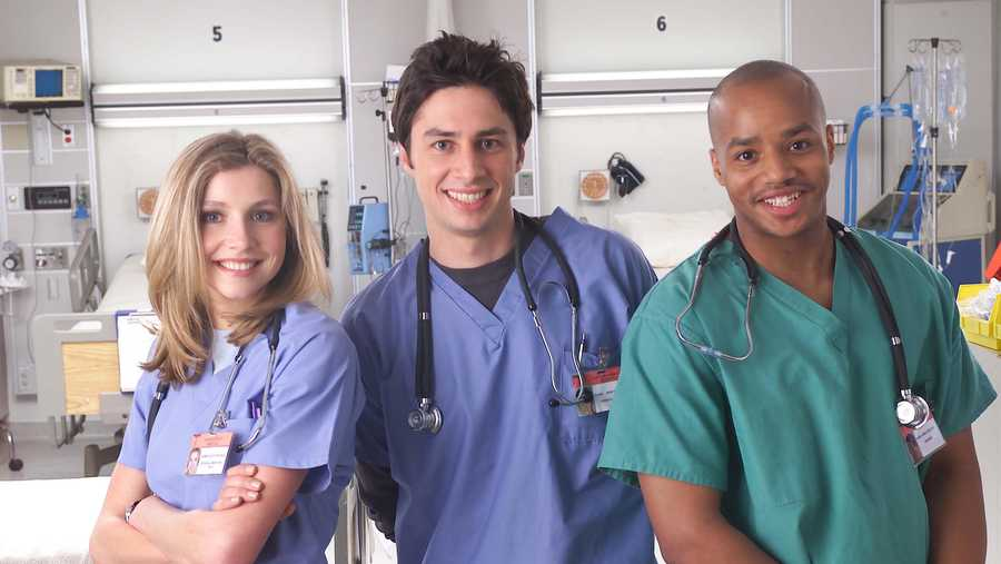 "Actors Sarah Chalke, Zach Braff and Donald Faison pose for a publicity photo for the TV show ""Scrubs."""