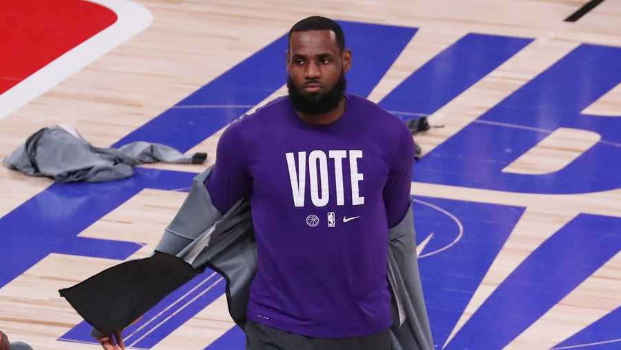 LeBron James #23 of the Los Angeles Lakers wears a VOTE shirt during warm-up prior to the start of the game against the Miami Heat in Game Five of the 2020 NBA Finals at AdventHealth Arena at the ESPN Wide World Of Sports Complex on Oct. 9, 2020 in Lake Buena Vista, Florida.