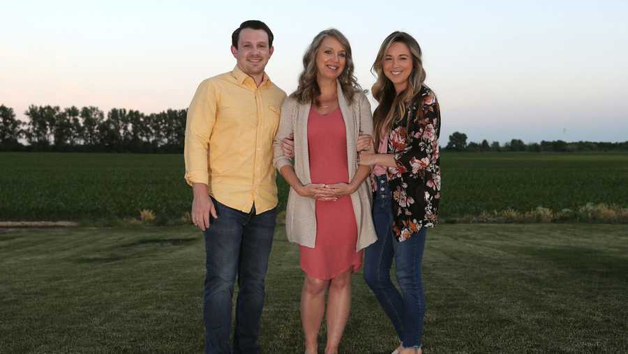 Julie Loving, center, poses for photographs with her son-in-law, Aaron Lockwood, and her daughter, Breanna Lockwood, at the Lockwood home on June 18, 2020, in Manteno, Ill.