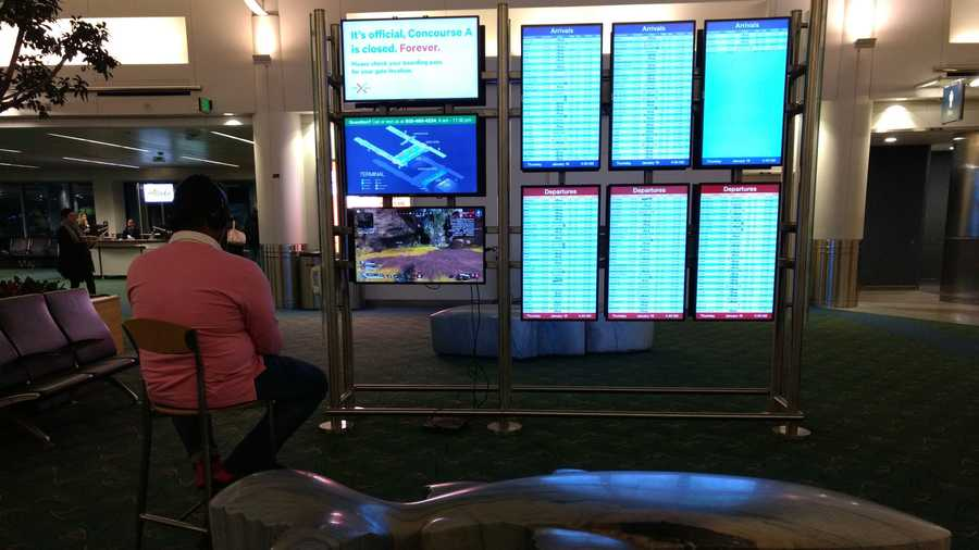 A man traveling through Oregon's Portland International Airport on Thursday was caught playing a video game on one of the airport's video monitors.