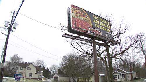 The East of Chicago Pizza store in Barberton, Ohio, is known for its cheeky billboards. But its last one made light of human trafficking, taking things a touch too far for locals.