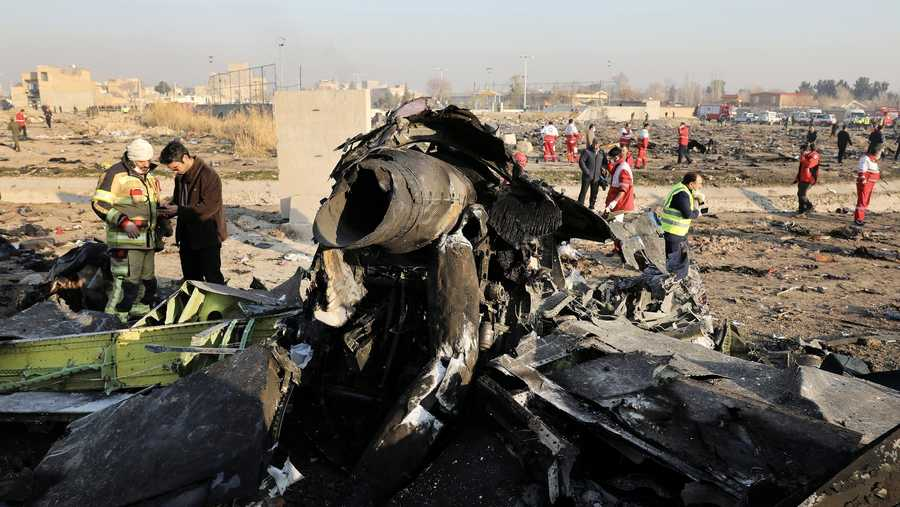 In this Jan. 8, 2020, file photo, debris at the scene where a Ukrainian plane crashed in Shahedshahr southwest of the capital Tehran, Iran. Iranian media are quoting the outgoing military prosecutor of Tehran as saying that 10 officials have been indicted for the 2020 shootdown of a Ukrainian passenger plane.