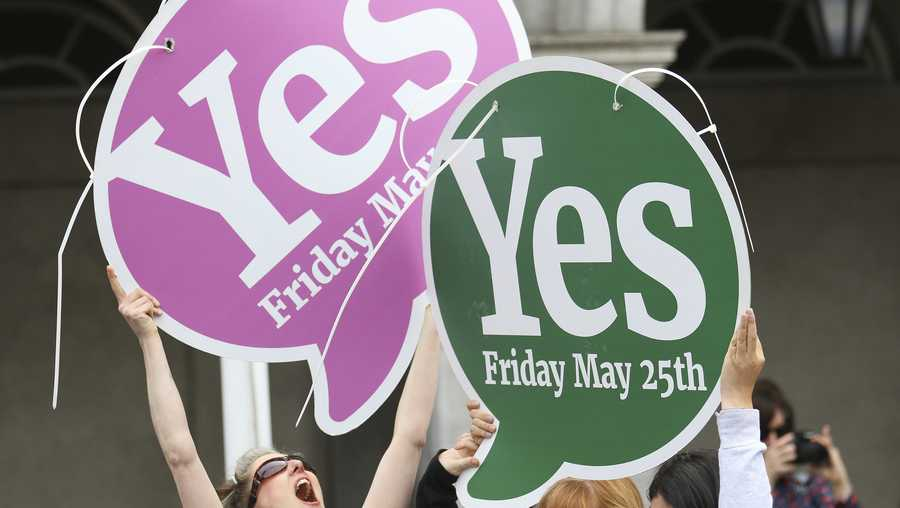 "People from the ""Yes"" campaign react as the results of the votes begin to come in, after the Irish referendum on the 8th Amendment of the Irish Constitution at Dublin Castle, in Dublin, Ireland, Saturday May 26, 2018."