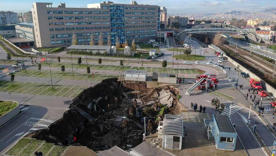 A huge sinkhole swallowed several cars and forced the evacuation of a COVID-19 ward after opening up in the parking lot of a hospital in southern Italy on Jan. 8.