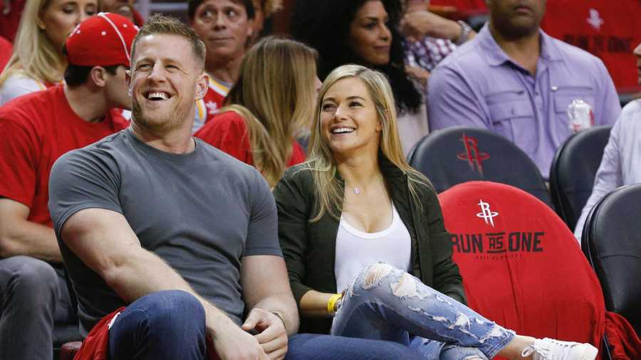 J.J. Watt and Kealia Ohai sit court-side during Game One of the first round of the Western Conference 2017 NBA Playoffs at Toyota Center on April 16, 2017 in Houston, Texas.