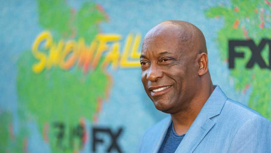 "John Singleton arrives to the premiere Of FX's ""Snowfall"" Season 2 at Regal Cinemas L.A. LIVE Stadium 14 on July 16, 2018 in Los Angeles"