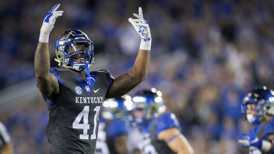 Kentucky linebacker Josh Allen (41) rallies fans during the second half of the team's NCAA college football game against South Carolina in Lexington, Ky., Saturday, Sept. 29, 2018. (AP Photo/Bryan Woolston)