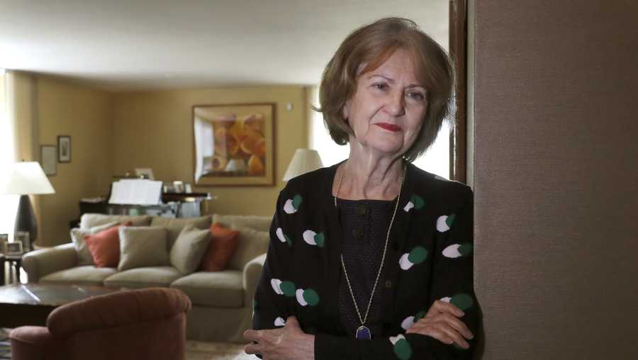 Senior U.S. District Judge Joan Lefkow, poses Monday, July 27, 2020, for a portrait in her Chicago home. In 2005, Lefkow returned from work to find her husband and mother shot dead in the basement of her Chicago home. Lefkow was forced to relive her family tragedy this month when a struggling lawyer armed with a gun and a grudge opened fire at the home of another female judge. (AP Photo/Charles Rex Arbogast)