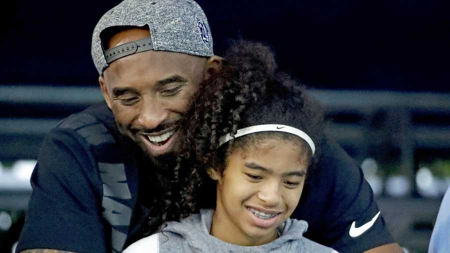 nba player kobe bryant and his daughter gianna watch during the us national championships swimming meet in 2018