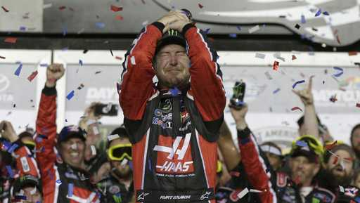 Kurt Busch celebrates in Victory Lane after winning the NASCAR Daytona 500 auto race at Daytona International Speedway in Daytona Beach, Fla., Sunday, Feb. 26, 2017.