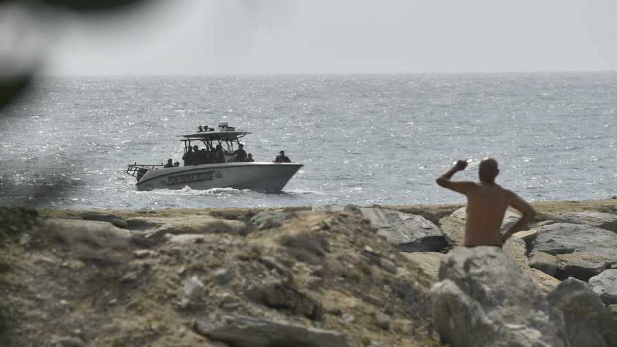 Security forces patrol near the shore in the port city of La Guaira, Venezuela, Sunday, May 3, 2020. Interior Minister Nestor Reverol said on state television that security forces overcame before dawn Sunday an armed maritime incursion with speedboats from neighboring Colombia in which several attackers were killed and others detained.