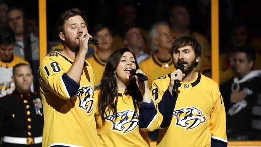 Country music trio Lady Antebellum sings the national anthem before Game 5 of an NHL hockey second-round playoff series between the Nashville Predators and the Winnipeg Jets Saturday, May 5, 2018.