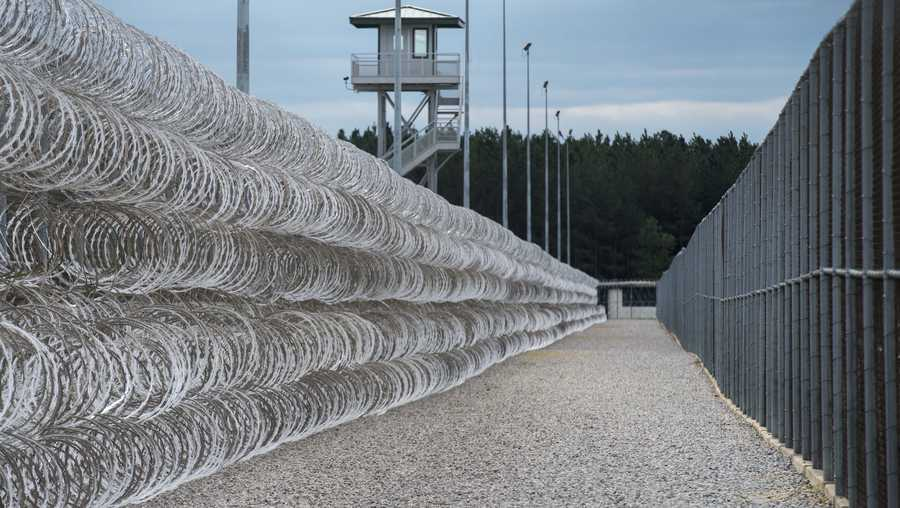 Razor wire protects a perimeter of the Lee Correctional Institution in Bishopville, S.C., Tuesday, Feb. 9, 2016. Lee, a maximum-security prison with nearly 1,500 inmates and filled with some of South Carolina's most violent, longest-serving offenders, has been known for riots and brutality.